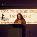 Convenor of Pakseana Matrimonial Services speaking at the event