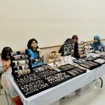 Ladies displaying a stall at Pakseana Matrimonial Event